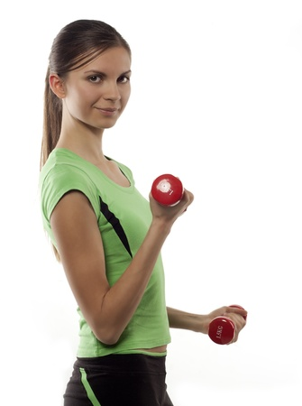 sports form: The girl with dumbbells in hands dressed in the sports form, costs on a white background