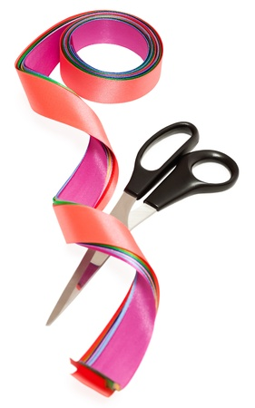 Scissors and a satin ribbons isolated on the white background Stock Photo