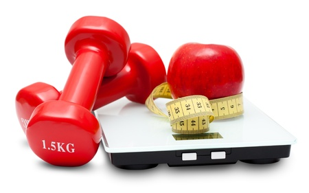 Scales, dumbbells, red apple and measuring tape isolated on the white background. Diet concept.