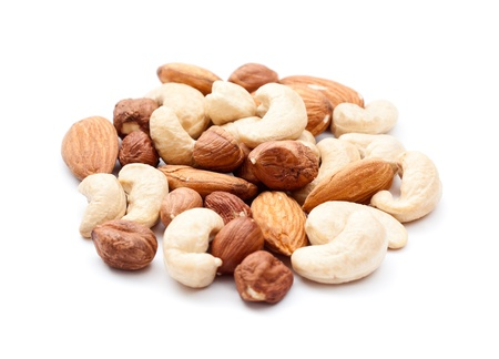 mixed nuts: Pile of mixed nuts isolated on the white background Stock Photo