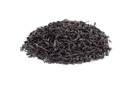 Dry leaves of black tea isolated on the white background