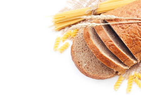 Fresh bread with wheat spikes and macaroni over white Stock Photo