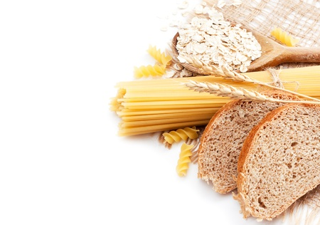 Fresh bread with wheat spikes, oat flakes and macaroni over white