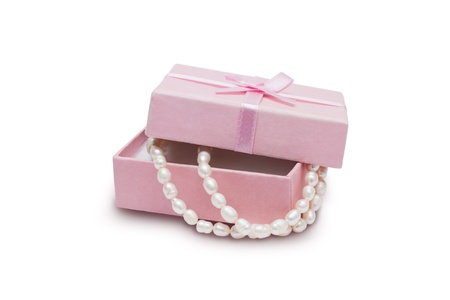 Jewelry box and pearl necklace isolated on white background photo