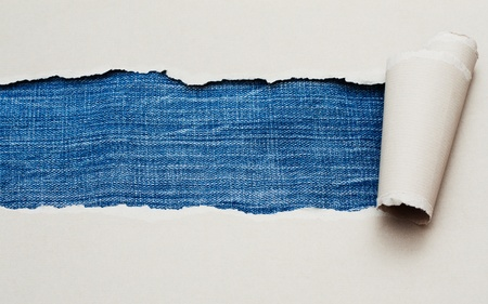 Torn paper with space for text with jeans texture background