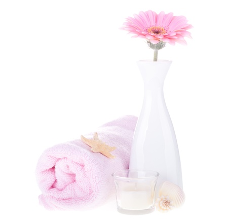 Vase with pink flower and towel on white background  Spa concept Stock Photo