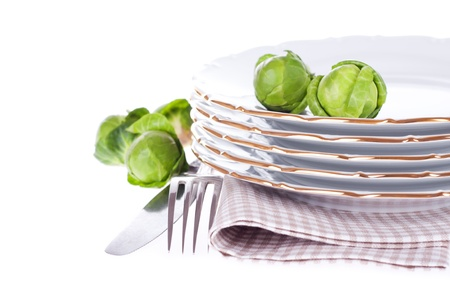 Set of dish, fork, knife, napkin and brussels sprouts on the white  With sample text Stock Photo