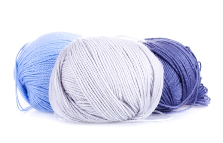 Three ball of woollen yarn on white background