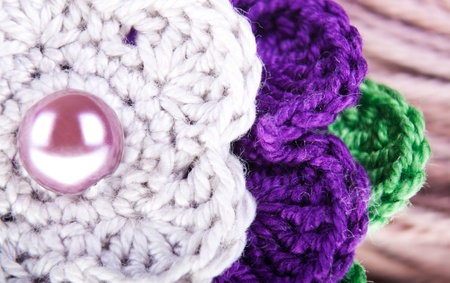 Background of the colored knitted flower close up  Stock Photo