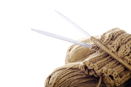 Skeins of yarn, needles and knitting work on the white background  With sample text