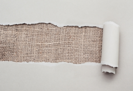 Torn paper with space for text with burlap texture background