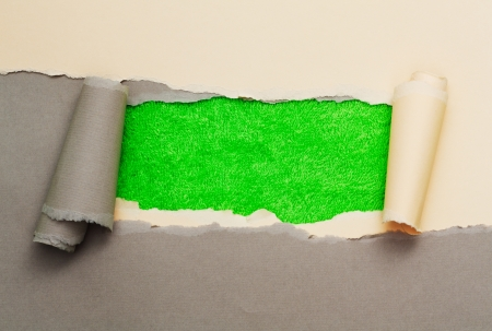 Torn paper with space for text with green terry texture background Stock Photo