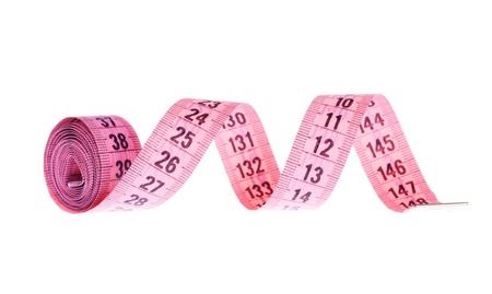 metro de medir: Pink cinta métrica sobre el fondo blanco