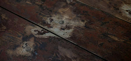 Rustic old dark wooden background. wooden boards. a combination of shades from burgundy to light brown. selective focus. perspective. diagonals and guides in the composition. artistic design.