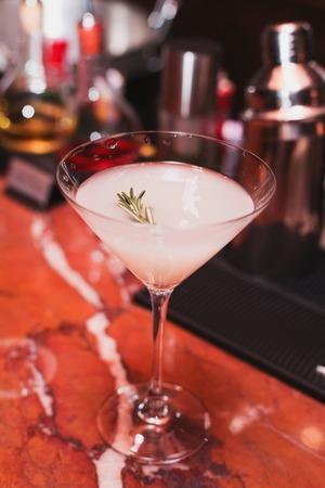 cocktail white sambuca tequila gin ice rosemary syrup vanilla cool refreshing drink bar Stock Photo