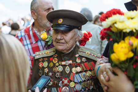 world war ii: UKRAINE, KIEV, MAY 9, 2016, Victory Day, May 9. Monument to an unknown soldier: Veterans of World War II carry flowers to the monument of an unknown soldier