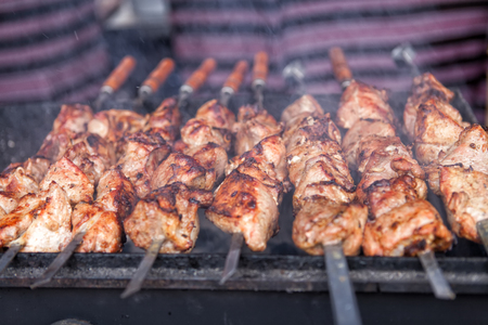 Appetizing shish kebab is fried on a skewers outdoor Stock Photo