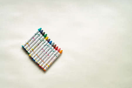Ð¡hildren's colorful drawing crayon chalks on the white background. Minimalistic wallpaper Archivio Fotografico
