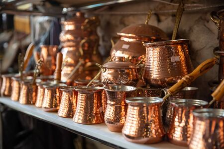 Bronze and copper handcrafted cookware in street shop. Shaki, Azerbaijan.