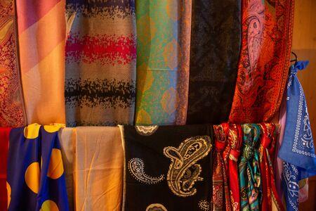 Traditional oriental cloth scarf sold in a store in old town Sheki, Azerbaijan. 免版税图像 - 140178954