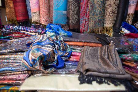 Traditional oriental cloth scarf sold in a store in old town Sheki, Azerbaijan. Stock fotó