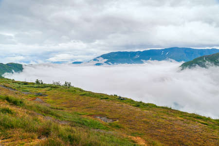 Canyon along the Norwegian National Road 13 filled with clouds. Norway