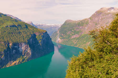 View of the Geiranger Fjord from the Eagle road viewpoint. Ornesvingen overlook. More og Romsdal county. Norway 版權商用圖片