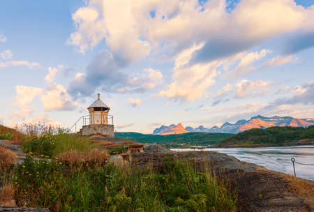 Old lighthouse on the shore of the Saltstraumen straitat sunset. Bodo municipality Nordland county. Norway