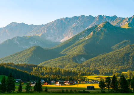 Alpine landscape with a small Austrian village just before sunset. State of Tyrol. Austria. 版權商用圖片