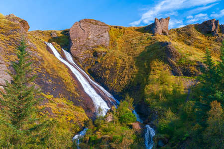 View of Systrafoss waterfall in the village of Kirkjubaejarklaustur (Klaustur) in early autumn. Iceland 版權商用圖片