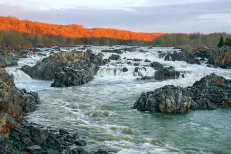 View of the Great Falls of the Potomac River at winter sunrise. Virginia. USA