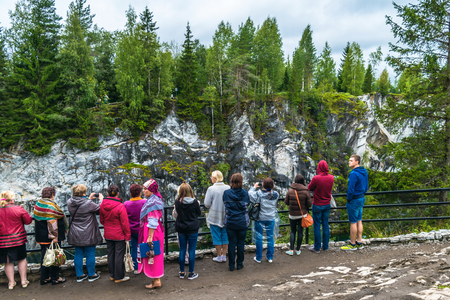 Village Ruskeala, Sortavala, Republic of Karelia, Russia, August 14, 2016: Mountain Park, Tourists on the marble canyon