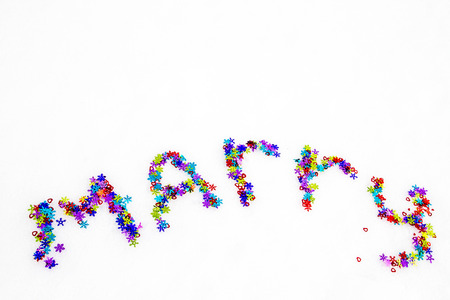 marry: The inscription on snow marry Stock Photo