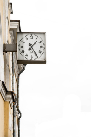 black clock hands: Lomonosov, St. Petersburg, Russia-February 12, 2015.The clock on the station building of Lomonosov St. Petersburg Editorial