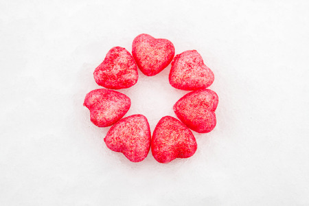 coldly: Pink hearts in the snow Stock Photo
