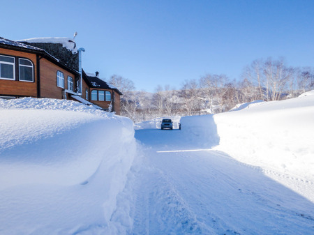 coldly: Winter view recreation center with large snow drifts