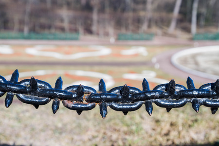 obstruction: Decorative fence hanging chain obstruction Stock Photo