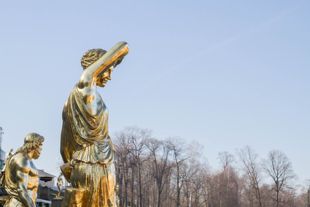 petrodvorets: Russia, St. Petersburg, city of Petrodvorets, March 16, 2015. The Golden sculpture in the Park of fountains in the city of Peterhof