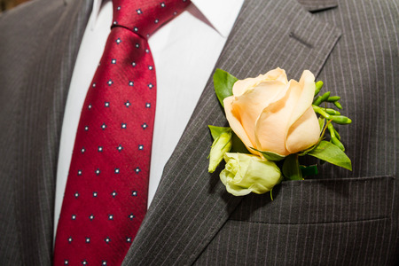 boutonniere: Boutonniere the groom in a suit Stock Photo