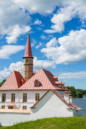 priory: Leningrad region,Gatchina, Russia, June 05, 2015. Priory Palace on the shore of the black lake in Gatchina.