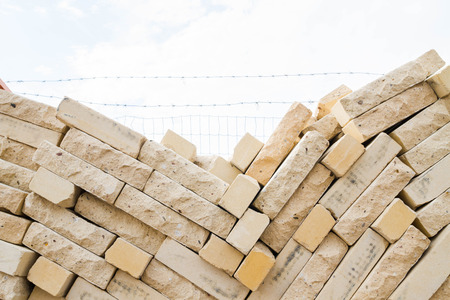 warehouse building: Facing bricks stacked in a warehouse building base Stock Photo