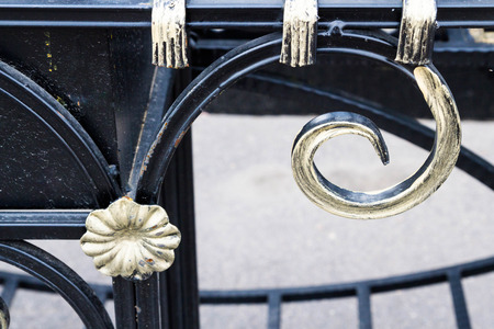 gilt: Black metal grill with gilt paint