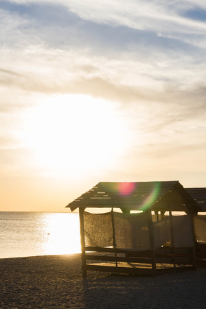 beach huts: Beach huts for shelter from the sun at sunset Stock Photo