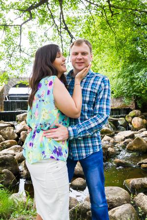 man waterfalls: Lovers walk in the Park in summer