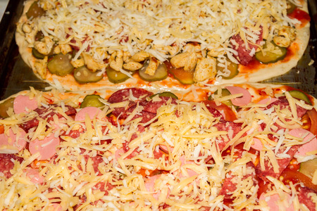 toppings: Cooking pizza with variety of toppings