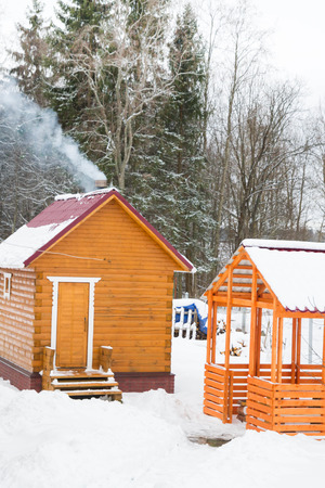 coldly: Wooden bath with a gazebo outside the city in winter
