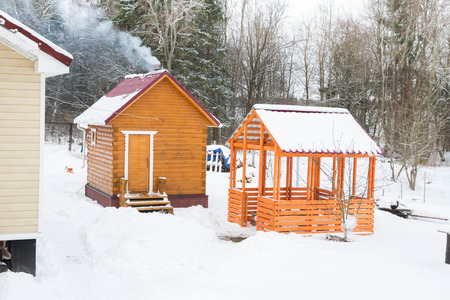 gazebo: Wooden bath with a gazebo outside the city in winter