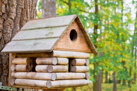 Wooden birdhouse in a beautiful autumn Park Stock Photo