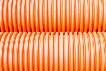 round chairs: Construction orange and black plastic pipes Stock Photo