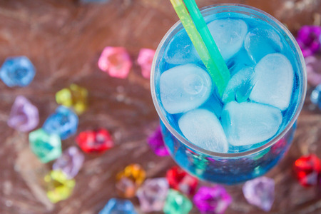 Colourful cocktails with ice on the beach in the hot summer